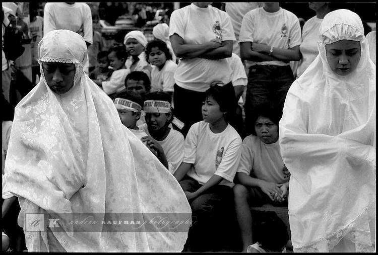 Summer '99-- Jakarta, Indonesia -- Muslim women pray in the streets during a protest.