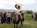 Armenia 2007 <br />  A Yezidi wedding in a village : the pillow of the bride showing to the guests<br /> Armenie 2007 <br /> Un mariage yezidi dans un village: l'oreiller de la mariée et les invités