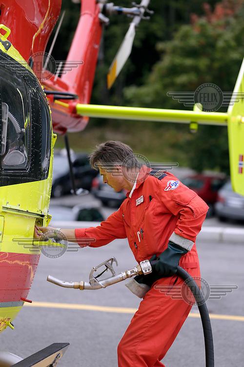 Thor Jarle Hande refuels Norwegian Air Ambulance helicopter EC-135