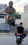 A photo taken on January 7, 2021 shows the newly unveiled bust of Iran's military commander, Qasem Soleimani, in the predominantly-Shiite Muslim Beirut southern suburb of Ghobeiry. - Soleimani -- whom the US blamed for attacks on its interests in Iraq and elsewhere -- was killed in a US drone strike at Baghdad airport on January 3 last year, ratcheting up tensions between decades-old arch foes the United States and Iran. Photo by Haitham Moussawi