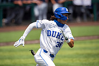 Duke Blue Devils center fielder Joey Loperfido (36) hustles to first base against the Liberty Flames in NCAA Regional play on Robert M. Lindsay Field at Lindsey Nelson Stadium on June 4, 2021, in Knoxville, Tennessee. (Danny Parker/Four Seam Images)