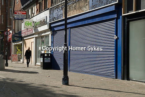 High street shops have gone out of business four in a row in Staines. Middlesex. UK