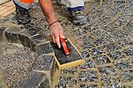 Construction work, Baustelle, Pflastersteine, Arbeit, Arbeiter, Bauarbeiter, Hand, Vaduz, Liechtenstein