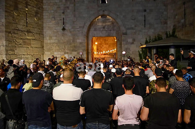 Israeli police and protesters scuffle outside Damascus Gate after barriers that were put up by Israeli police are removed, allowing access to the main square that has been the focus of a week of clashes around Jerusalem's Old City April 25, 2021. Photo by Marihan Al-Khalidi