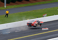 Sep 14, 2014; Concord, NC, USA; NHRA pro stock driver V. Gaines flips over as he crashes during the first round of the Carolina Nationals at zMax Dragway. Gaines was uninjured in the incident. Mandatory Credit: Mark J. Rebilas-USA TODAY Sports