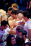 Antonio Esfandiari shares a ahug with his father, Bejan, after winning the Big One For One Drop Tournament.