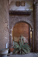 """Rome Colle Aventino, Basilica of Santa Sabina .atrium statue of St. Dominic<br /> The basilica of Santa Sabina all'Aventino is a Catholic place of worship in the historic center of Rome, located on the Aventine hill, in the territory of Rione XII Ripa. Built in the 5th century on the tomb of Santa Sabina, as well as one of the best preserved early Christian churches ever,<br /> <br /> The Basilica of Saint Sabina (Latin: Basilica Sanctae Sabinae, Italian: Basilica di Santa Sabina all'Aventino) is a historic church on the Aventine Hill in Rome, Italy. It is a titular minor basilica and mother church of the Roman Catholic Order of Preachers, better known as the Dominicans.<br /> <br /> Santa Sabina is the oldest extant Roman basilica in Rome that preserves its original colonnaded rectangular plan and architectural style. Its decorations have been restored to their original restrained design. Other basilicas, such as Santa Maria Maggiore, are often heavily and ornately decorated. Because of its simplicity, the Santa Sabina represents the crossover from a roofed Roman forum to the churches of Christendom. It is especially famous for its 5th-century carved wood doors, with a cycle of Christian scenes (18 now remaining) that is one of the earliest to survive.<br /> <br /> Santa Sabina is perched high above the Tiber to the north and the Circus Maximus to the east. It is next to the small public park of Giardino degli Aranci (""""Garden of Oranges""""), which has a scenic terrace overlooking Rome. It is a short distance from the headquarters of the Knights of Malta.<br /> History<br /> Santa Sabina was built by Peter of Illyria, a Dalmatian priest, between 422 and 432  near a temple of Juno on the Aventine Hill in Rome. The church was built on the site of early Imperial houses, one of which is said to be of Sabina, a Roman matron originally from Avezzano in the Abruzzo region of Italy. Sabina was beheaded under the Emperor Vespasian, or perhaps Hadrian, because she had been conv"""