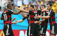 Thomas Muller of Germany celebrates with team mates after scoring his goal to make the score 1-0