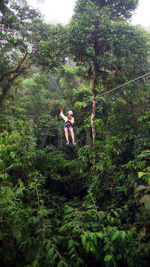 Woman riding zip-line in Coasta Rica