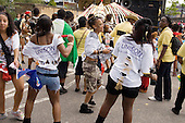 Teenagers wearing Unison T-shirts join the parade on Children's Day at Notting Hill Carnival