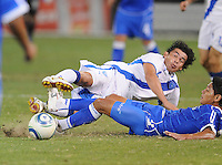 Guatemala midfielder Sergio Guevarra (14)   goes against El Salvador defender Victor Turcios (2)    The Guatemalan National Team defeated  El Salvador National Team 2-0 in a friendly international at RFK Stadium, Saturday September 7, 2010.