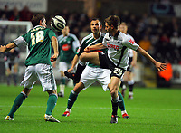 ATTENTION SPORTS PICTURE DESK<br /> Pictured: Joe Allen of Swansea (R) challenged by Gary Sawyer (L) of Plymouth Argyle<br /> Re: Coca Cola Championship, Swansea City Football Club v Plymouth Argyle at the Liberty Stadium, Swansea, south Wales. Tuesday 08 December 2009