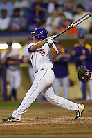 LSU Tigers third baseman Christian Ibarra #14 follows through on his swing against the Auburn Tigers in the NCAA baseball game on March 22nd, 2013 at Alex Box Stadium in Baton Rouge, Louisiana. LSU defeated Auburn 9-4. (Andrew Woolley/Four Seam Images).