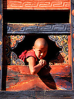 Portrait of a young Buddhist monk at the Simtokha Dzong monastery and fortress, Bhutan.