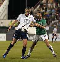 Abby Wambach of USA (L) and Natalie Vinti of Mexico (R) during the semifinal match of CONCACAF Women's World Cup Qualifying tournament held at Estadio Quintana Roo in Cancun, Mexico. Mexico 2, USA 1.
