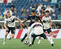 FOXBOROUGH, MA - JULY 17: Gustavo Bao #7 dribbles in a crowd during a game between Vancouver Whitecaps and New England Revolution at Gillette Stadium on July 17, 2019 in Foxborough, Massachusetts.