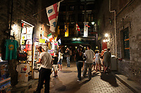 Montreal (Qc) CANADA - Sept 1st  2008 - people walk beside vendors.Stalls on Saint-Amable street near Place Jacques-Cartier,.OLd-Montreal at night..