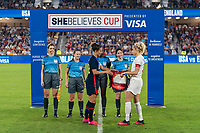 ORLANDO, FL - MARCH 05: Carli Lloyd #10 of the United States and Steph Houghton #5 of England exchange banners during the coin flip during a game between England and USWNT at Exploria Stadium on March 05, 2020 in Orlando, Florida.