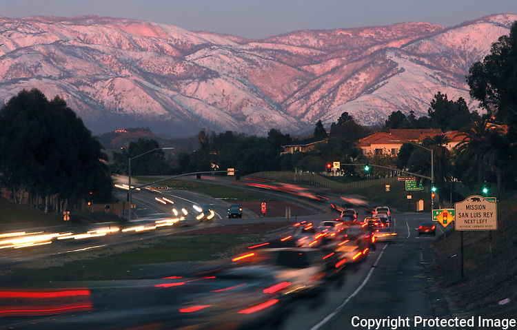 Snow-capped mountains greet motorists heading east on Highway 76 in Oceanside, California, on Valentine's Day in 2008. photo for North County Times