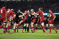 Pictured: A fight breaks out between Dane Coles (in black L) of New Zealand and Wales players Saturday 22 November 2014<br />