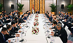A handout picture provided by the Egyptian Presidency on April 26, 2019 shows Egyptian President Abdel Fattah al-Sisi meeting with Chinese businessmen in Beijing, China. Photo by Egyptian President Office