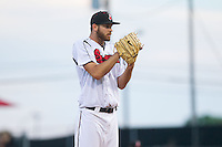 Nashville Sounds starting pitcher Taylor Jungmann (33) looks to his catcher for the sign against the Oklahoma City RedHawks at Greer Stadium on July 25, 2014 in Nashville, Tennessee.  The Sounds defeated the RedHawks 2-0.  (Brian Westerholt/Four Seam Images)