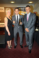 Pictured: Joe Allen (C) receiving the Young Player of the Year Award presented to him by Lineside Rail. Thursday 10 May 2012<br /> Re: Swansea City FC awards dinner at the Liberty Stadium.