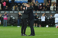 Alan Curtis, assistant coach for Swansea gives Graham Potter Manager of Swansea City a hug at full time during the Sky Bet Championship match between Swansea City and Derby County at the Liberty Stadium in Swansea, Wales, UK. Wednesday 01 May 2019