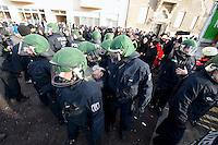 Mehrere tausend Menschen protestierten am Samstag den 18. Januar 2014 in Magdeburg gegen eine Demonstration von ca. 700 Neonazis. Die Nazis demonstrierten in Gedenken an die Bombardierung von Magdeburg am 16.1.1945 durch die Alliierten.<br />Die Polizei verhinderte erfolgreich alle Blockadeversuche der Gegendemonstranten. Dafür waren Polizeieinheiten aus Berlin, Niedersachsen, Sachsen und Hessen nach Magdeburg beordert worden.<br />Im Bild: Beamte der 21. Einsatzhunderschaft der Berliner Polizei nehmen in einer Protest-Kundgebung vor dem Bahnhof Magdeburg-Neustadt eine Frau fest. Der Zugfuehrer mit der Dienstnummer 21100 drueckt dabei der Frau mit seinen Fingern mit einem sog. Schmerzgriff die Augen ein.<br />18.1.2014, Magdeburg<br />Copyright: Christian-Ditsch.de<br />[Inhaltsveraendernde Manipulation des Fotos nur nach ausdruecklicher Genehmigung des Fotografen. Vereinbarungen ueber Abtretung von Persoenlichkeitsrechten/Model Release der abgebildeten Person/Personen liegen nicht vor. NO MODEL RELEASE! Don't publish without copyright Christian-Ditsch.de, Veroeffentlichung nur mit Fotografennennung, sowie gegen Honorar, MwSt. und Beleg. Konto:, I N G - D i B a, IBAN DE58500105175400192269, BIC INGDDEFFXXX, Kontakt: post@christian-ditsch.de<br />Urhebervermerk wird gemaess Paragraph 13 UHG verlangt.]