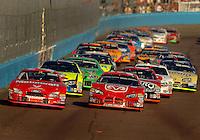 Nov 13, 2005; Phoenix, Ariz, USA;  Nascar Nextel Cup drivers Ricky Rudd and Kasey Kahne lead the field during the Checker Auto Parts 500 at Phoenix International Raceway. Mandatory Credit: Photo By Mark J. Rebilas