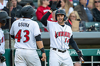 Eric Wood (14) of the Indianapolis Indians greeted teammate Pablo Osuna (43) after he scored at Victory Field on May 14, 2019 in Indianapolis, Indiana. The Indians defeated the RailRiders 4-2. (Andrew Woolley/Four Seam Images)