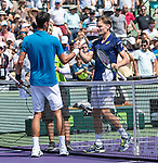 April 1 2016: Novak Djokovic (SRB), on left, shakes hands with David Goffin (BEL) at the Miami Open being played at Crandon Park Tennis Center in Miami, Key Biscayne, Florida. ©Karla Kinne/Tennisclix/Cal Sports Media