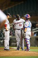 Surprise Saguaros pitching coach Ivan Arteaga (22), of the Minnesota Twins organization, talks with catcher Jose Trevino (13), of the Texas Rangers organization,and pitcher Michael Kopech (50), of the Boston Red Sox organization, during a game against the Salt River Rafters on October 21, 2016 at Salt River Fields at Talking Stick in Scottsdale, Arizona.  Salt River defeated Surprise 3-2.  (Mike Janes/Four Seam Images)