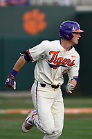 Shortstop Logan Davidson (8) of the Clemson Tigers runs out a batted ball in a game against the Furman Paladins on Tuesday, February 20, 2018, at Doug Kingsmore Stadium in Clemson, South Carolina. Clemson won, 12-4. (Tom Priddy/Four Seam Images)