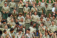 Scouts cheer during a ceremony at Camp Raven Knob Scout Reservation, one of the largest Boy Scout camps in the United States. Camp Raven Knob is located within Boy Scouts of America's Old Hickory Council in Mt. Airy, North Carolina. Order of the Arrow is BSA's national honor society. Using American Indian-styled traditions and ceremonies, Order of the Arrow bestow recognition on exemplary Scouts.