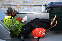 Fishing for sockeye salmon on the F/V Okuma in the Nushagak River in Bristol Bay in Alaska on July 6, 2019. During peak season deckhands get little sleep or time for meals. (Photo by Karen Ducey)
