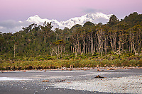 Twilight over Southern Alps with Aoraki Mount Cook from wild beach of South Westland, Westland Tai Poutini National Park, UNESCO World Heritage Area, West Coast, New Zealand, NZ