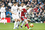 Real Madrid's James Rodriguez (l) and Danilo Luiz da Silva (c) and Real Sociedad's Imanol Agirretxe during La Liga match. December 30,2015. (ALTERPHOTOS/Acero)
