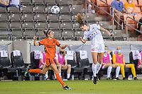 HOUSTON, TX - APRIL 09: Kayla Sharples #28 of the Chicago Red Stars heads the ball past Shea Groom #6 of the Houston Dash during a game between Chicago Red Stars and Houston Dash at BBVA Stadium on April 09, 2021 in Houston, Texas.