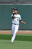 Cedar Rapids Kernels Christian Cavaness (8) catches fly ball during the game against the Clinton LumberKings at Veterans Memorial Stadium on April 17, 2016 in Cedar Rapids, Iowa.  Clinton won 7-2.  (Dennis Hubbard/Four Seam Images)
