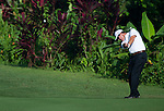 D.A. Points on his second shot on the first fairway during Round 2 of the CIMB Asia Pacific Classic 2011.  Photo © Raf Sanchez / PSI for Carbon Worldwide
