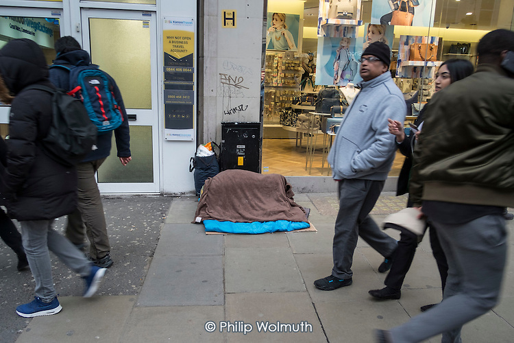 Sleeping place and belongings of homeless rough sleeper, Oxford Street, London