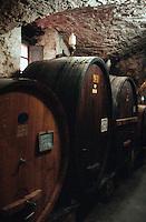 Barrels in cantina wine cellar, Castellina Chianti, Italy