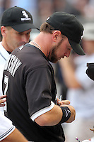Chicago White Sox first baseman Mark Kotsay (7) signs autographs before a game vs. the Detroit Tigers at U.S. Cellular Field in Chicago, Illinois August 13, 2010.   Chicago defeated Detroit 8-4.  Photo By Mike Janes/Four Seam Images