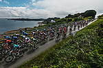 The peloton ride along the coastline during Stage 2 of the 2021 Tour de France, running 183.5km from Perros-Guirec to Mur-de-Bretagne Guerledan, France. 27th June 2021.  <br /> Picture: A.S.O./Charly Lopez   Cyclefile<br /> <br /> All photos usage must carry mandatory copyright credit (© Cyclefile   A.S.O./Charly Lopez)