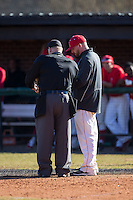 Belmont Abbey Crusaders head coach Chris Anderson (right) gives lineup changes to the home plate umpire during the game against the Shippensburg Raiders at Abbey Yard on February 8, 2015 in Belmont, North Carolina.  The Raiders defeated the Crusaders 14-0.  (Brian Westerholt/Four Seam Images)