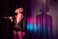The Kleine Nacht Revue Club in Berlin which has politically satirical, sexy, dramatic and comic revues. In a recreation of the decadent days of the Weimar Republic, a cabaret floorshow dramatises the life of Marlene Dietrich, along with other acts of a more risque nature.