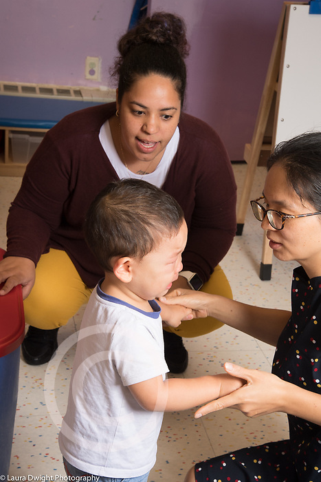 Education Preschool Phase-in First Days of School toddler 2s program mother saying goodbye to her son, female teacher nearby