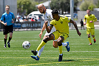 Kris Naicker of the Wellington Phoenix competes for the ball with Stephen Hoyle of Eastern Suburbs during the ISPS Handa Men's Premiership - Wellington Phoenix v Eastern Suburbs at Fraser Park, Wellington on Saturday 28 November 2020.<br /> Copyright photo: Masanori Udagawa /  www.photosport.nz