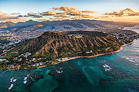A sunrise helicopter tour provides an uncommon view of Diamond Head Crater along the southeastern coast of O'ahu.